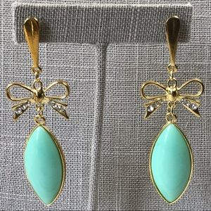 Aqua blue dangle earrings with rhinestone bows